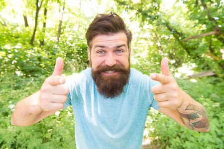 Hipster with long beard emotional face close up nature background. Go wild. Hair care male beauty. Summer fun. Bearded guy in park forest. Bearded hipster. Crazy bearded man in natural environment