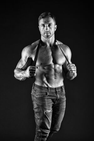 He got perfect torso. muscular man hold leather belt. fetish. bdsm love game. Sportsman with muscular chest belly. Sport fitness. Masculinity and brutality. man with sexy muscular torso look brutally