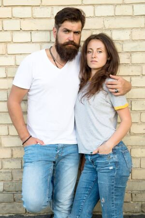 Lets just love together. Couple being in love relations hugging on brick wall. Bearded man and sensual woman enjoying romantic relations. Family relations and bonding. Relations and relationship Banco de Imagens