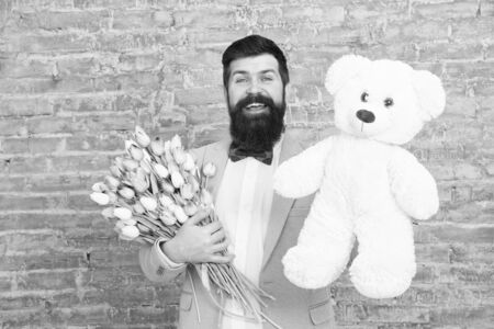 Happy spring day. man in love. Spring gift. Bearded man hipster with flowers. Bearded man with tulip bouquet, bear. Love date. international holiday. Flower for March 8. Womens day. Happy bearded man