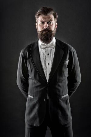 Well dressed and scrupulously neat. Hipster formal suit tuxedo. Official event dress code. Male fashion. Classic style. Classic never out of trend. Menswear classic outfit. Bearded man with bow tie