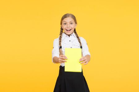 School girl excellent pupil prepared essay or school project. Raising independence. Schoolgirl wear school uniform. Knowledge day. Girl with copy book or workbook. Kid student ready with homework