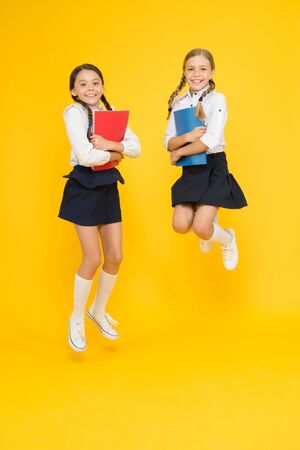 Bring child school few days prior play playground and get comfortable. Cheerful school girls. Back to school. Point out positive aspects starting school create positive anticipation first day class Stockfoto