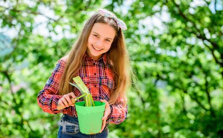 little girl with gardening tools. earth day. summer farm. Happy childhood. spring village country. little girl kid in forest. ecology environment. Happy childrens day. child gardening Stock Photo