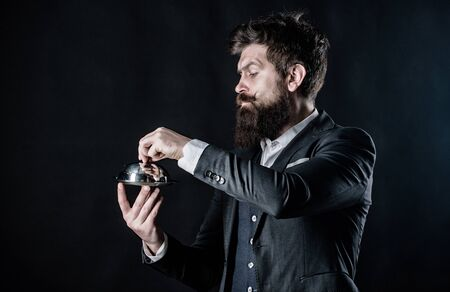 Best chef ever. Mature hipster with beard hold food tray in restaurant. brutal caucasian hipster hold metallic dish. businessman in suit. Waiter man. Perfect recipe. Bearded man chef presenting meal
