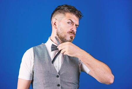 Giving a clean shave. Barber with vintage barber tool. Razor barber shop. Bearded man with straight razor. Brutal man with beard holding shave razor. Hipster with retro razor for shaving beard Stockfoto