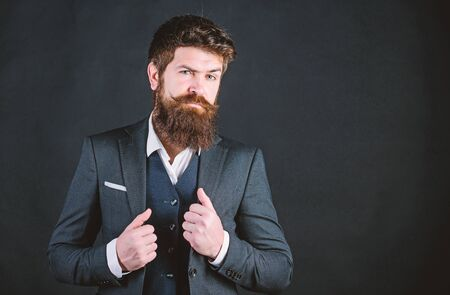 Impeccable style. Businessman fashionable outfit black background. Man bearded guy wear suit outfit. Perfect elegant tuxedo outfit. Elegancy and male style. Fashion concept. Guy wear formal outfit