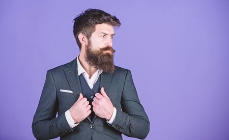 Impeccable style. Businessman fashionable outfit stand violet background. Man bearded hipster wear classic suit outfit. Formal outfit. Elegancy and male style. Fashion concept. Guy wear formal outfit