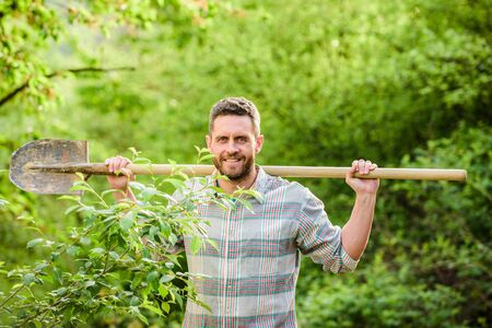 sexy farmer hold shovel. muscular ranch man. farming and agriculture cultivation. Garden tools. Eco farm worker. Harvest. happy earth day. Eco living. he knows everything about flowers 版權商用圖片