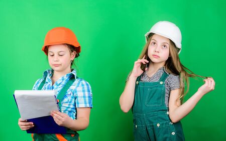 Future profession. Kids girls planning renovation. Initiative children girls provide renovation their room green background. Renovation plan. Home improvement activities. Builder engineer architect