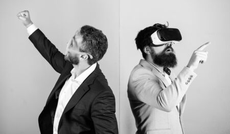 Business implement modern technology. Man with beard in VR glasses and louvered plastic accessory. Guy interact in virtual reality. Hipster exploring virtual reality. Real fun and virtual alternative