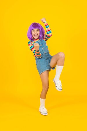 Cosplay character concept. Culture hobby and entertainment. Cosplay outfit. Otaku girl in wig smiling on yellow background. Happy childhood. Anime fan. Cosplay kids party. Child cute cosplayer