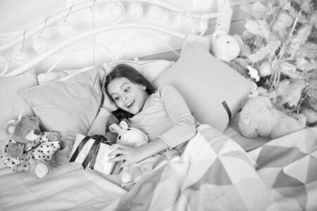 small girl sleeping at home. christmas family. happy new year. Christmas shopping. waiting for santa. Winter. The morning before Xmas. Sleep. little child girl with xmas present. Just look at that Stock Photo
