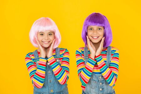 Anime cosplay party concept. Animation style characterized colorful graphics vibrant characters fantastical themes. Happy little girls. Anime fan. Cheerful friends in colorful wigs. Anime convention