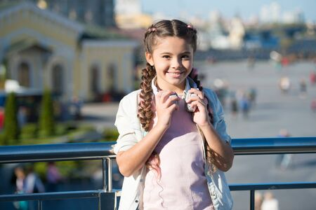 Mp3 player. Little girl listening audio book. Little girl listen music. Child smiling face relax outdoors on sunny day. Music in headphones. Modern headphones. Music for long walks. Vacation mood