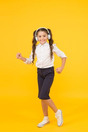 Education and fun concept. Online schooling. Listening lesson. Sing song. Child enjoy music sound. Audio schooling. Home schooling. Small girl pupil headphones. Child happy listen music. Audio book
