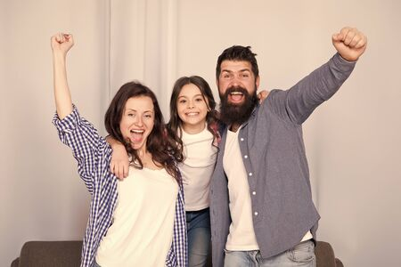 Reunited and it feel so good. Father, mother and happy child at home. Family day. Happy family. Little girl love her parents. Bearded man and woman with daughter. Childrens day. happy childhood Banque d'images