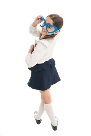 In love with education. Smart kid concept. School club. Child enjoy learning. School project. Adorable bookworm. Schoolgirl heart shaped glasses white background. Child girl school uniform hold book Stockfoto