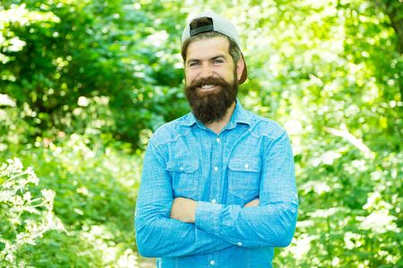 feel happiness. guy in forest. summer camping. happy bearded man. Mature hipster with beard. male facial care. brutal man with beard. barber. hispter style. Fashion portrait of man. Hair beard care Фото со стока