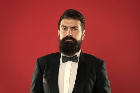 Bearded man in tuxedo and bow tie. Formal event. bearded man groom with beard in wedding suit. Businessman in tailored tuxedo. Formal wear male fashion. bearded hipster man. bearded groom in tuxedo Фото со стока - 129245687