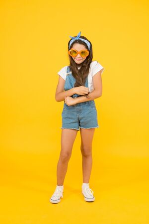 You can have anything you want in life if dress for it. Little fashionista. Cute kid fashion girl. Summer fashion concept. Girl long curly hair wear sunglasses and fancy tied headscarf. Fashion trend Stock fotó
