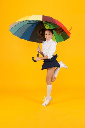 School time. Rainbow style. Colorful life. Schoolgirl happy with umbrella. Fall weather forecast. Fashion accessory. Umbrella protective shield. Girl with umbrella. Rainy day walks. Happy childhood