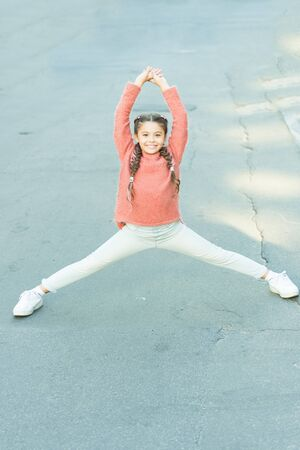 Active leisure. Beginning of great walk. Girl stretching before long walk. Little child enjoy activity. Kid walking running outdoors. Enjoy walk. Sport for kids. Vacation and free time. Easy exercise