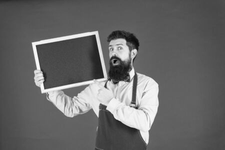 menu board. welcome. Restaurant or cafe advertising. bearded hipster cook. great cuisine. cooking by recipe. surprised man chef with blank blackboard, copy space. menu planning. our menu is best