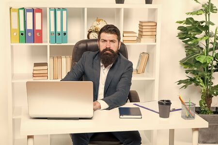 Office staff concept. Office routine. Businessman in charge of business solutions. Developing business strategy. Risky business. Man bearded boss sit with laptop. Manager solving business problems