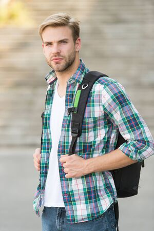 College education. College life. Modern student. College student with backpack urban background. Handsome guy study in university. Education boost successful future. Man regular student appearance Stock Photo