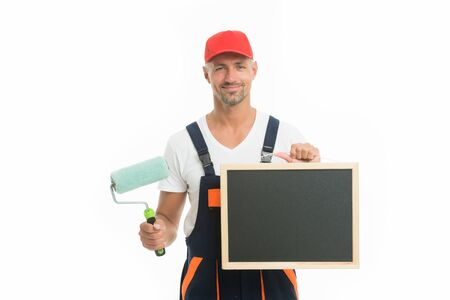 Good news. Decorator creative work. Professional occupation. Education for decorator. Paint and renovate. Decorator painting wall. Man in cap hold paint roller. Worker painter decorator concept