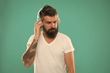 Man listening song in headphones. Tech gadgets all music lovers should have. Best gifts for music lovers. Bearded hipster wear headphones. Excellent sound. Music library concept. Music always with me Foto de archivo - 129246315