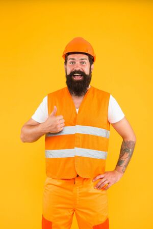 Good job. Engineering career concept. Architect builder engineer. Safety apparel for construction industry. Bearded brutal hipster safety engineer. Man engineer protective uniform orange background 스톡 콘텐츠