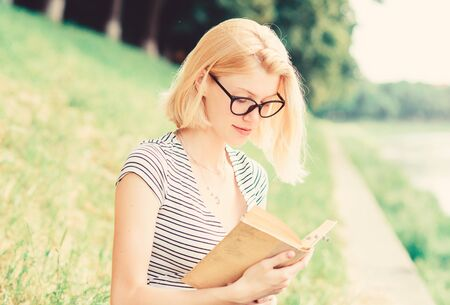 inspired by novel author. interesting story. Relax and get new information. woman in park reading book. reading is my hobby. Summer study. student girl with book outdoor. holding lesson book