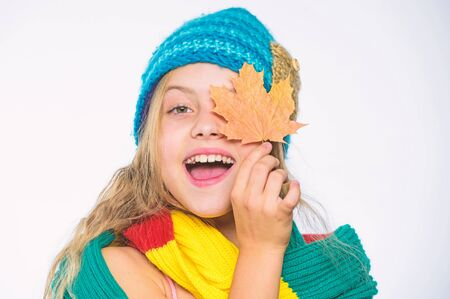 Top autumn beauty tips. Fall skin care tips from dermatologists. Beauty and health concept. Girl cute face wear knitted autumn hat and scarf hold leaf white background. Skin care tips for fall Standard-Bild - 129246829