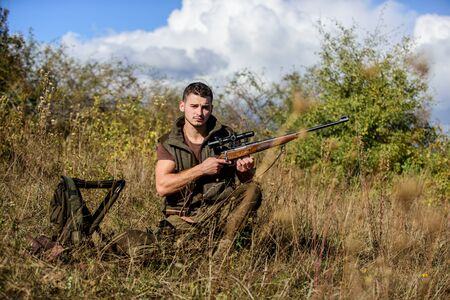 What you should have while hunting nature environment. Recharge rifle concept. Hunting equipment and safety measures. Man with rifle hunting equipment nature background. Prepare for hunting