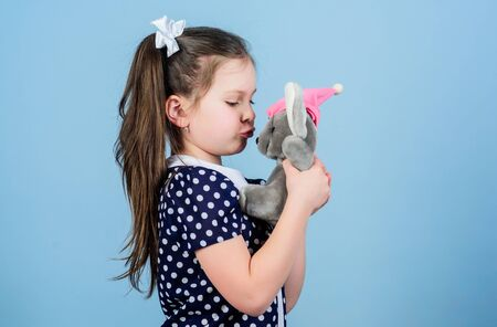 Lovely small girl with favorite toy. Kindergarten and educational games. Spreading love. Kid cute girl play with soft toy mouse. Happy childhood. Child care. Sweet childhood. Childhood concept Stock fotó