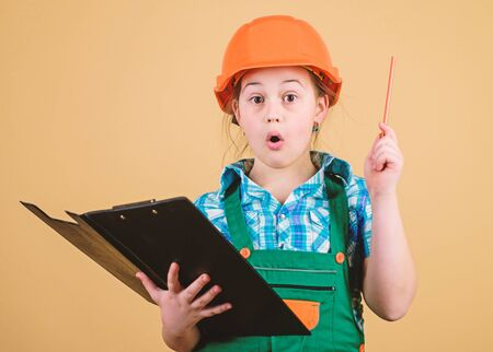 Foreman planning. Builder engineer architect. Future profession. Kid builder girl. Build your future yourself. Initiative child girl hard hat builder worker. Child care development. Safety expert
