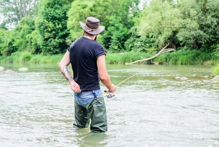 hobby and sport activity. pothunter. bearded fisher in water. summer weekend. Big game fishing. fisherman with fishing rod. mature man fly fishing. man catching fish. Deep Sea Fishing.
