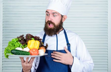 Vegetarian salad with fresh vegetables. Healthy food cooking. Mature hipster with beard. surprised bearded man. chef recipe. Dieting organic food. Cuisine culinary. Vitamin. Daily task Stockfoto