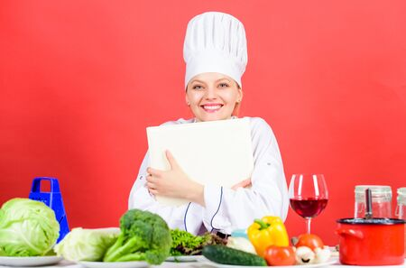 Tips and advice. Preparing food. Delicious and gourmet. Cooking food as hobby. Cook looking for cooking recipe in cookbook. Woman reading cook book in kitchen. Girl cook at kitchen table ingredients