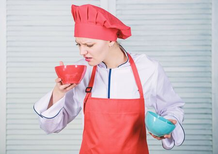 Calculate normal portion of food. Calculate your food servings size. Diet and dieting concept. How many portions would you like to eat. Woman cook hold bowls. Calculate amount calorie you consuming