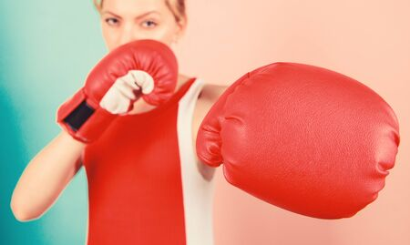 Woman boxing gloves focused on attack. Ambitious girl fight boxing gloves. Female rights. I am gonna kick you off. Confident in her boxing skill. Boxing improve temper and will. Concentrated on punch Stockfoto
