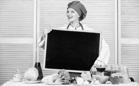 Staff wanted. Woman chef hat apron hold blackboard copy space. Chef job position. Cooking delicious meal step by step. Cooking menu for today. List ingredients cooking dish. Looking for colleagues Banque d'images - 129253439