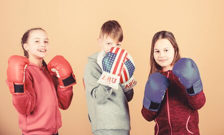 Friendly sparring. Boy and girls friends wear boxing gloves with usa flag. American sport concept. Children sporty practicing boxing skills. Boxing sport. Start boxing career. Self defence skills