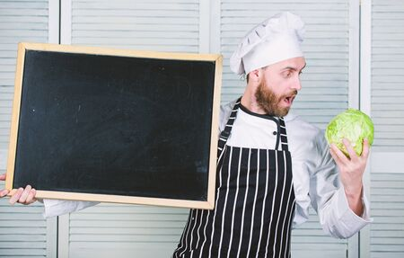 Recipe concept. Cooking delicious meal step by step. Menu for today. List ingredients for cooking dish. Check out cooking tips. Tips to cook like pro. Man chef hat apron hold blackboard copy space Banque d'images - 129253503