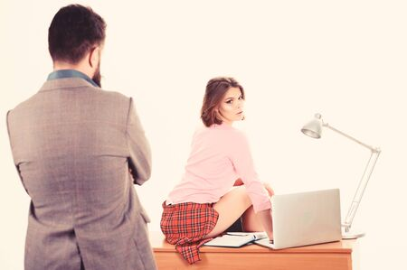 A new office employee. Adorable woman employee sitting at desktop while man looking at her. Professional female employee at workplace. administrative employee or secretary Zdjęcie Seryjne - 129253507