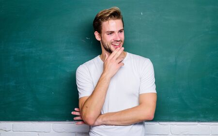 Teacher interesting speaker lecturer. Back to school. Teaching could be more fun. Master of simplification. Man teacher in front of chalkboard. Advantages for male elementary teacher are abundant