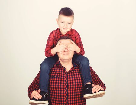 Having fun. Happiness being father of boy. Fathers day. Father example of noble human. Best friends forever. Father little son red shirts family look outfit. Dad piggybacking adorable child Zdjęcie Seryjne