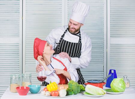 happy couple in love with healthy food. Dieting and vitamin. culinary cuisine. happy man and woman chef in restaurant. vegetarian. cook uniform. happy family cooking in kitchen. Family weekend